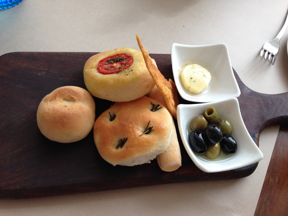 Bread platter with herb butter and olives